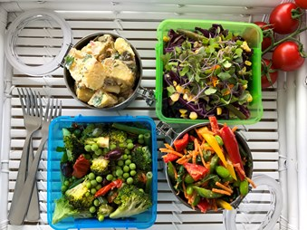 Overhead of a full healthy lunchbox.