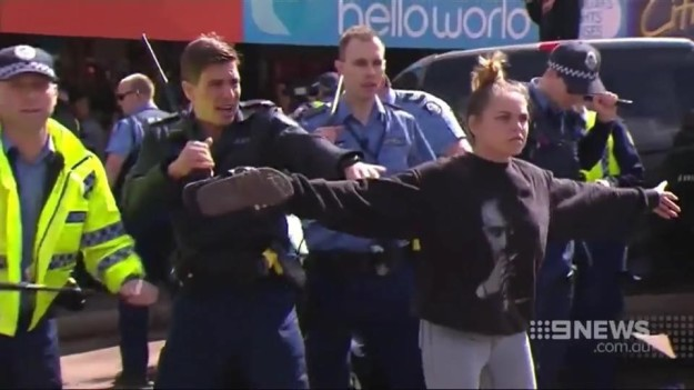 Hayley Garlett in Kalgoorlie, Western Australia, stares down a group of protesters as tensions flared on Tuesday in Kalgoorlie following the death of 14-year-old Aboriginal boy Elijah Doughty. Channel Nine