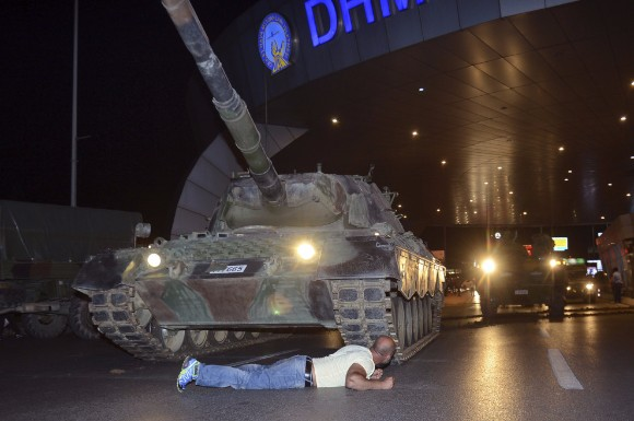 A man laid in front of a tank to try to keep it from entering Ataturk airport in Istanbul.